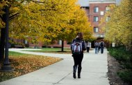 Students walk the grounds of University of Connecticut on Oct. 23, 2013, in Storrs, Conn.